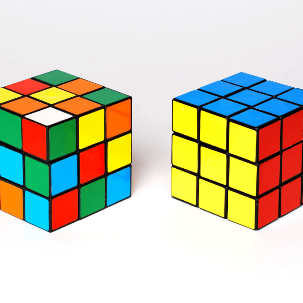 Two Rubik's cubes, one scrambled, the other completed