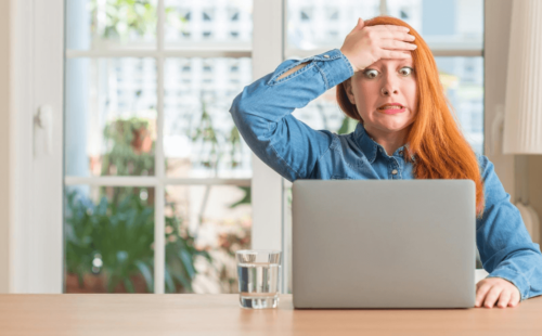 Lady looking in horror upon making one a common job references mistakes