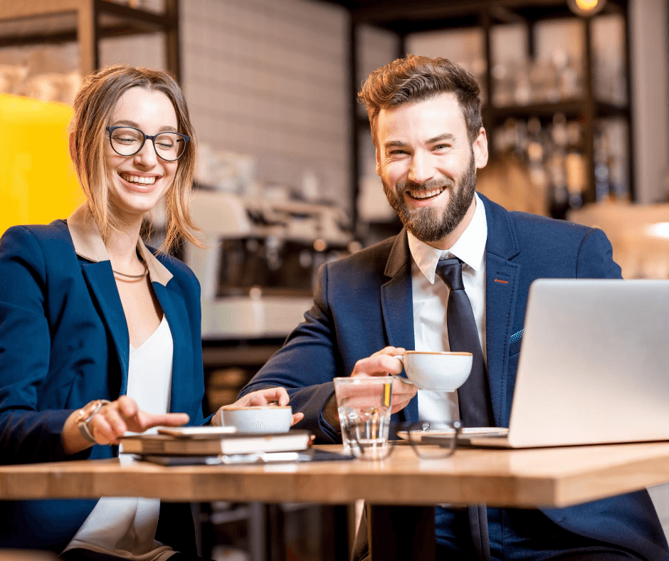 Two professional acquaintances discussing job references mistakes over coffee