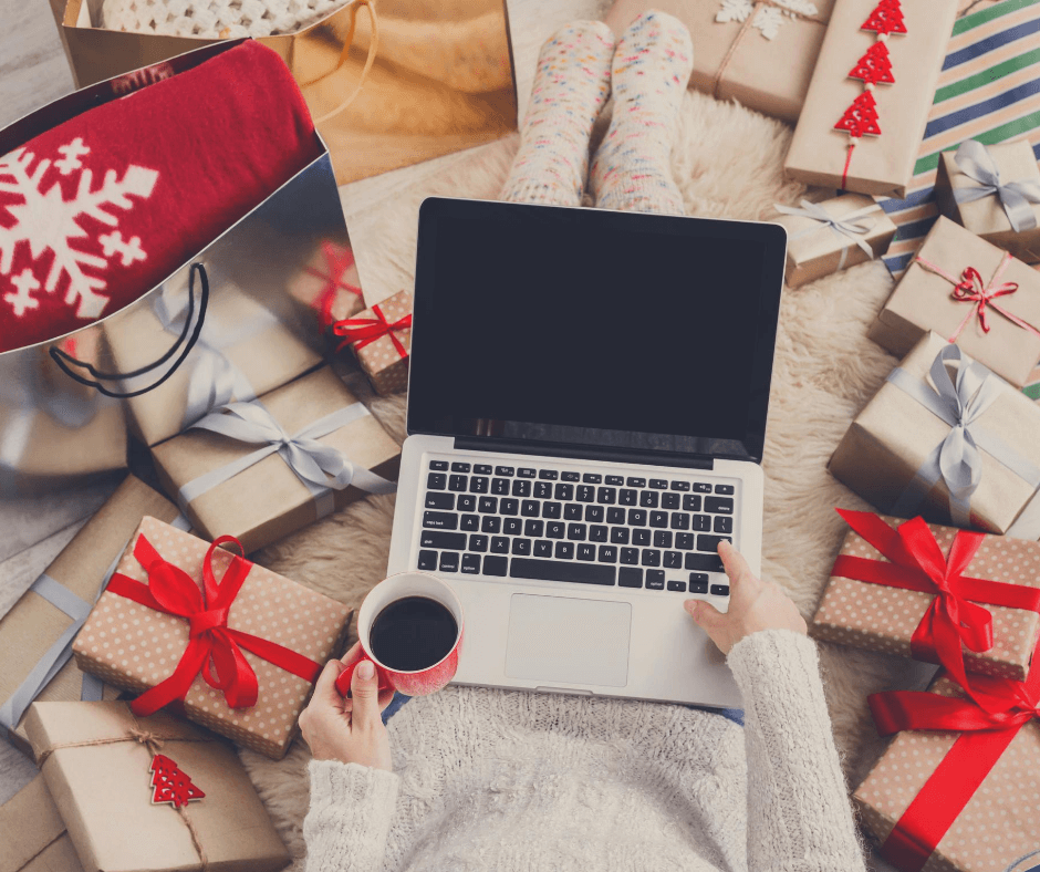 Lady using her laptop to complete all her Christmas preparations