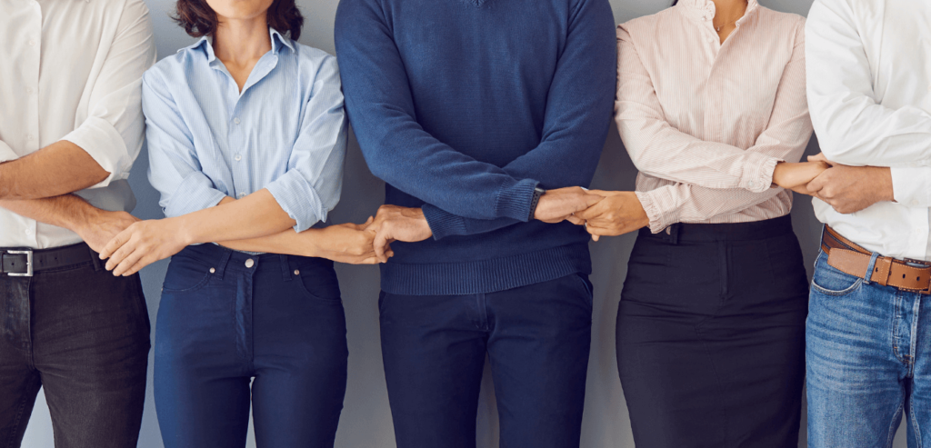 Employees working as a team to create a positive company culture