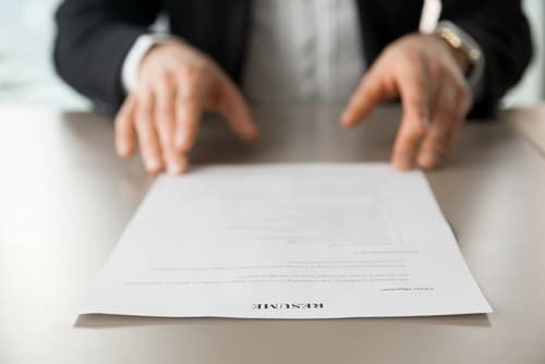 Man holding his CV maybe he could do with some CV tips