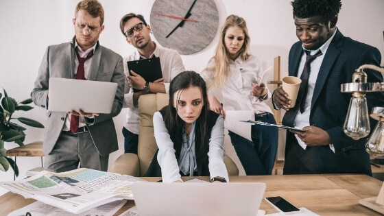 A team of workers who all look unhappy in their jobs they could be active or passive candidates
