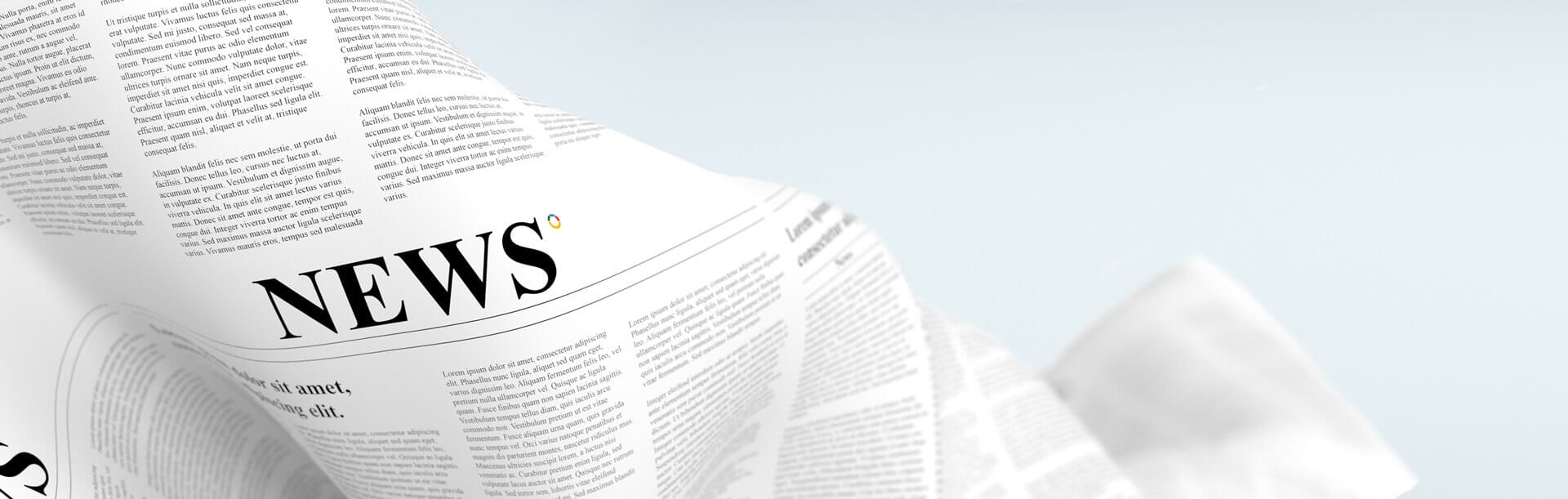 Photograph of a news paper article with Adria's Blog Post Logo.