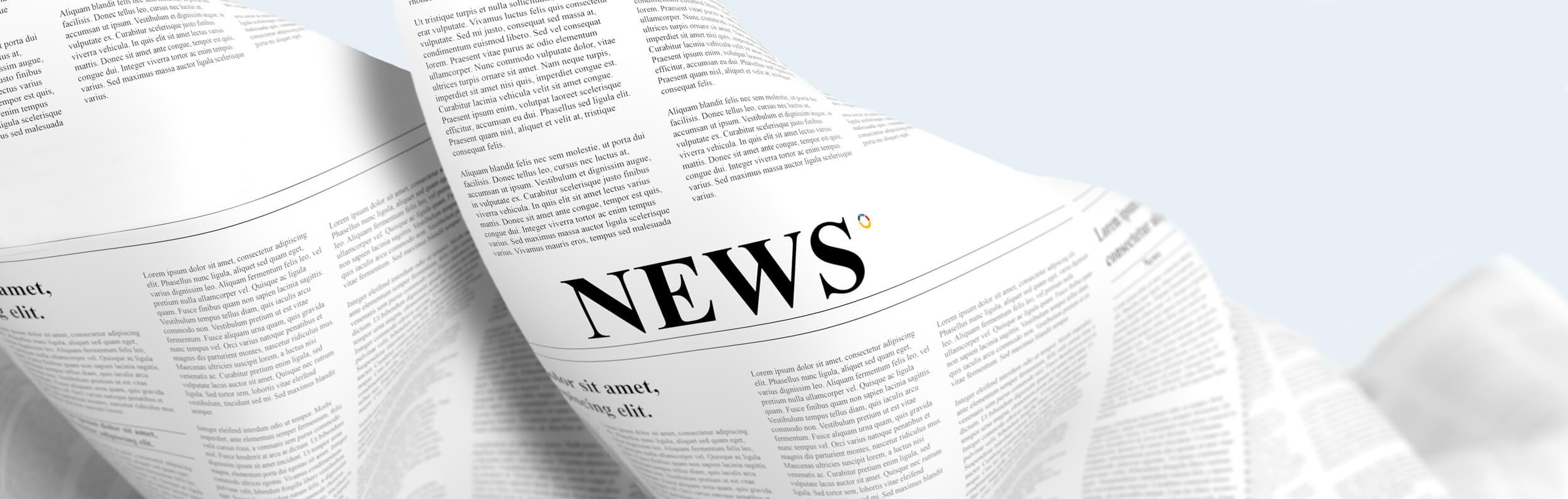 A newspaper subtly displaying the Adria logo