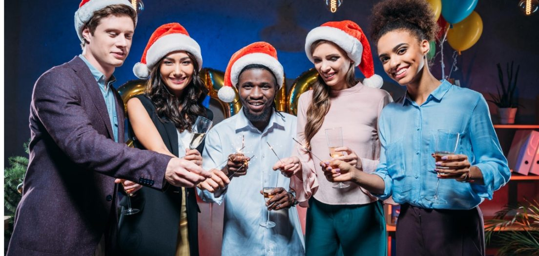 Work colleagues displaying excellent Christmas party etiquette