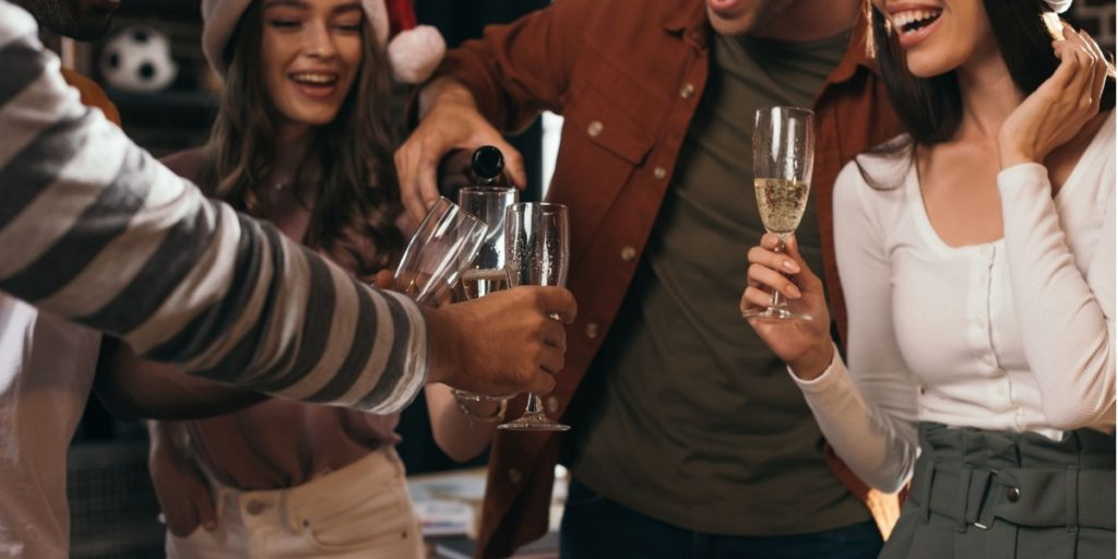 Colleagues at their Christmas Party drinking responsibly as part of great Party etiquette