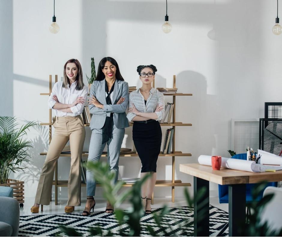 Female trio displaying positive attitudes