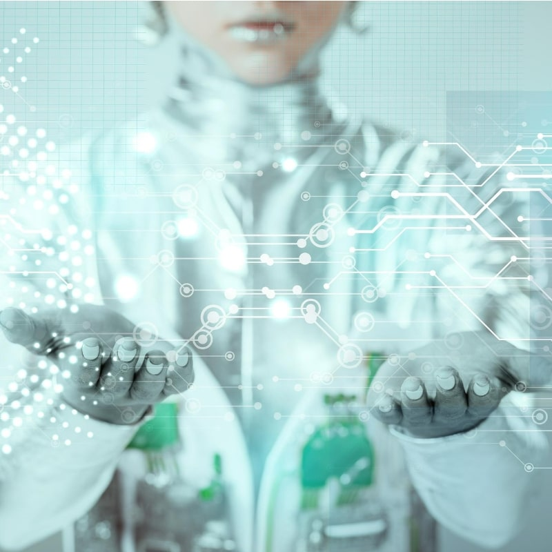 a sci-fi looking woman holding her hands out as if she has data in her hands