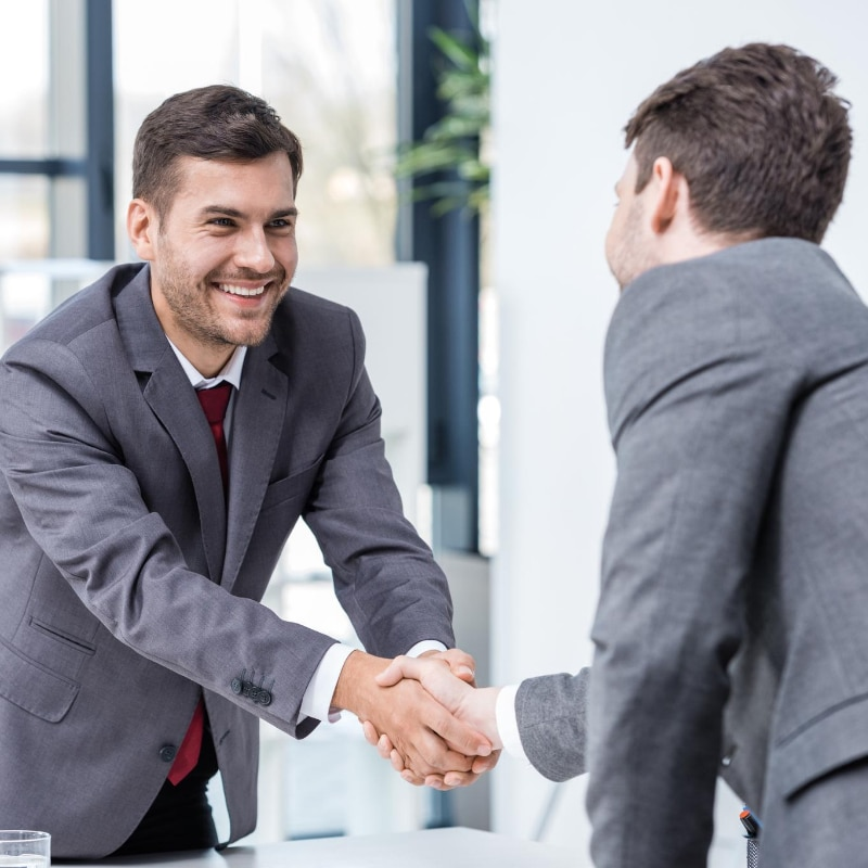 A quality recruitment consultant shaking their client's hand - the sign of a strong partnership