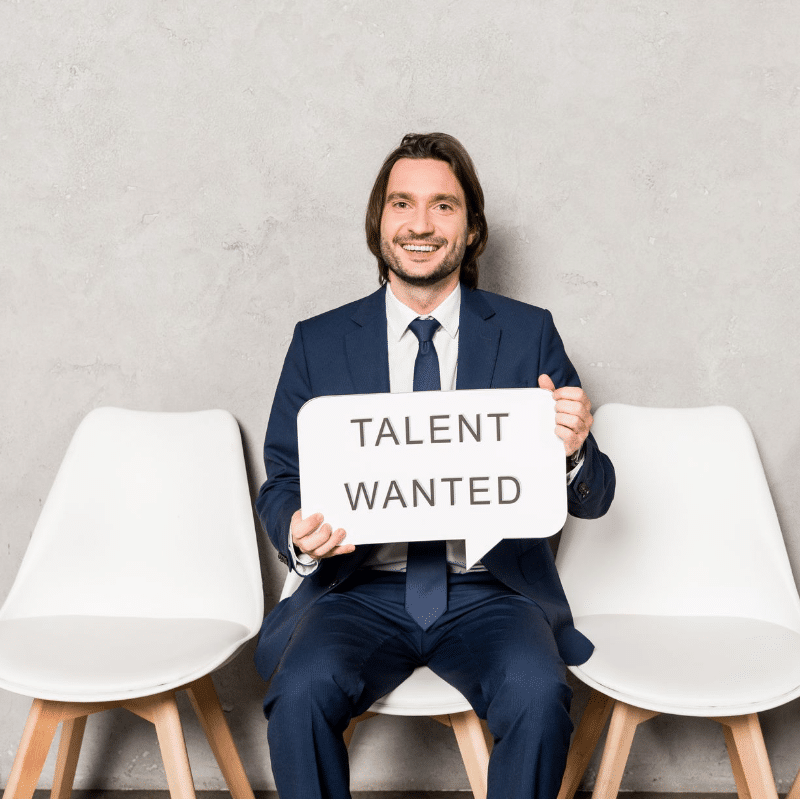 Can small businesses find the right talent? Yes, if they use better tactics than this man holding a sign saying talent wanted!