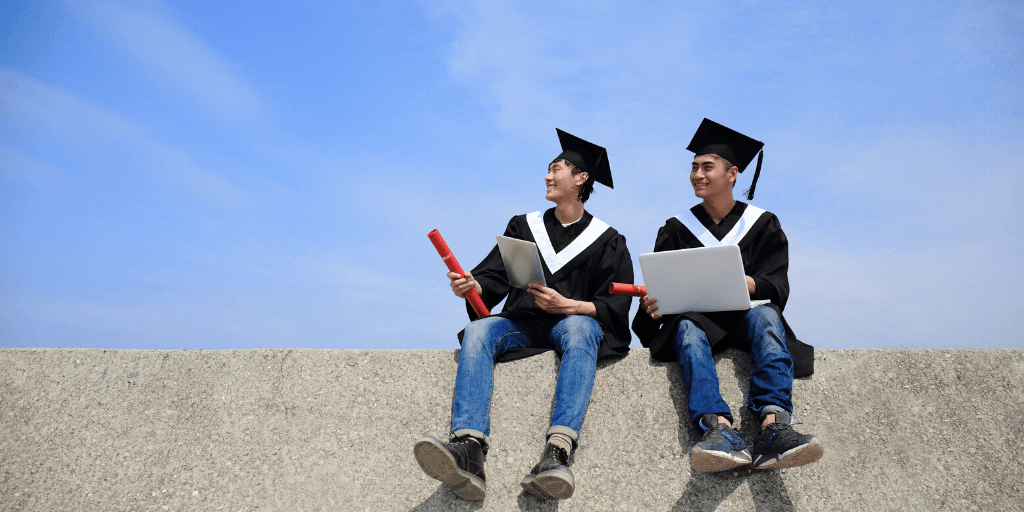 Two computer science graduates filled with hopes of achieving higher than average salaries