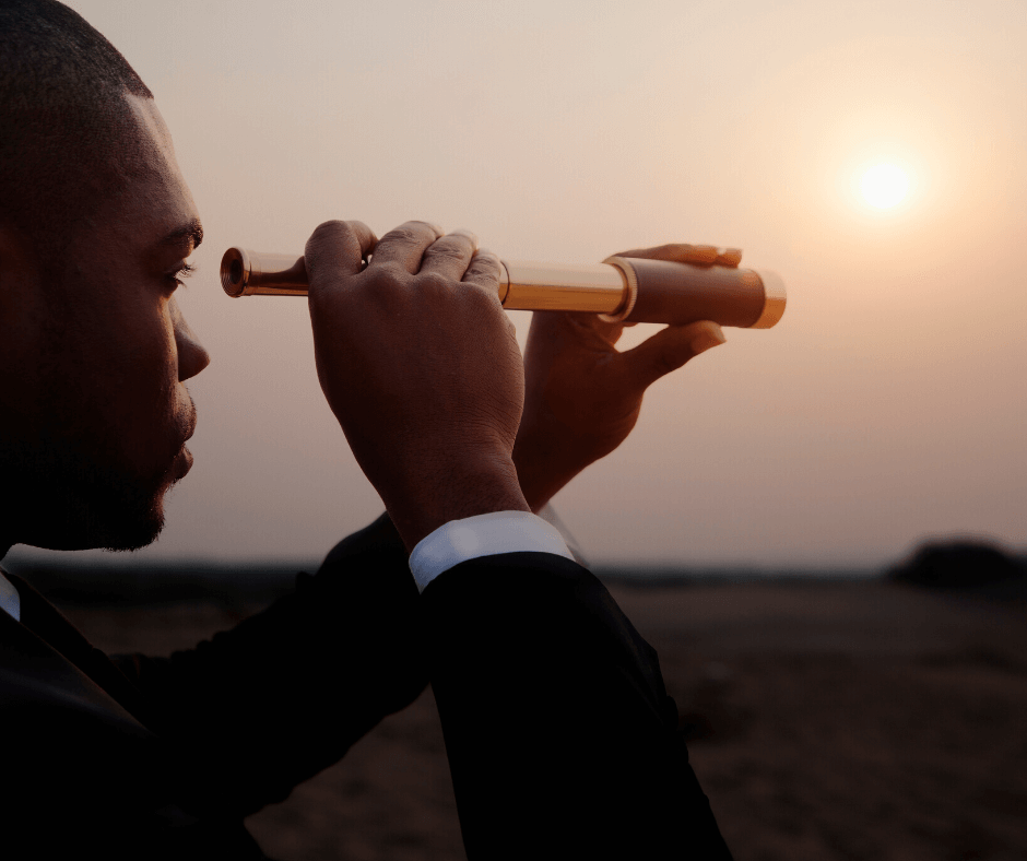 A headhunter looking for his next target with the aid of a telescope