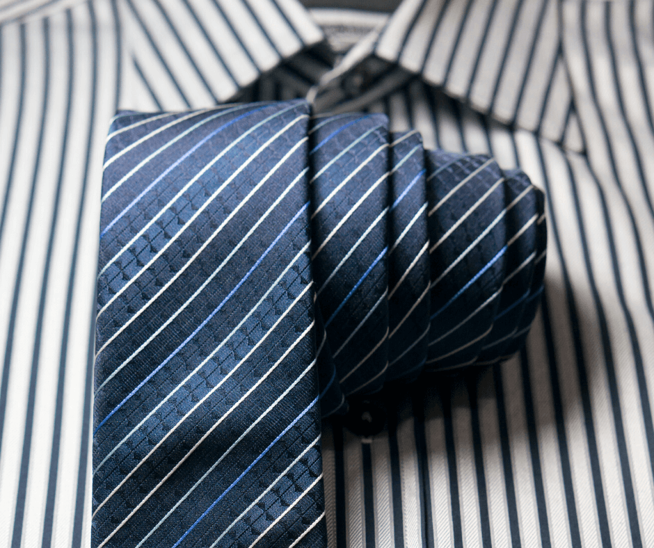 Striped tie rolled up against a contrasting striped shirt to demonstrate the moire effect