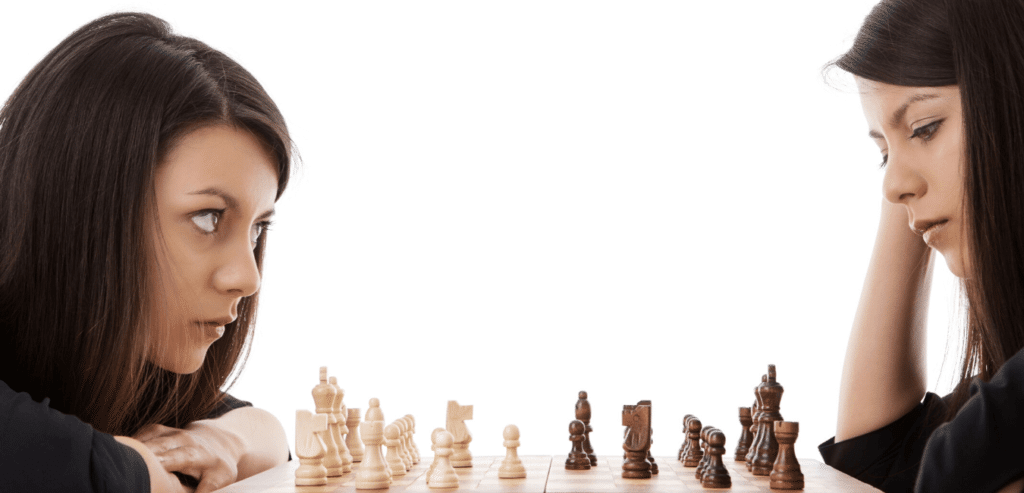 Girl playing herself at chess