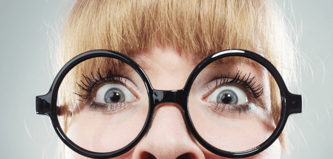Extreme close up lady looking scared by competency based interview questions