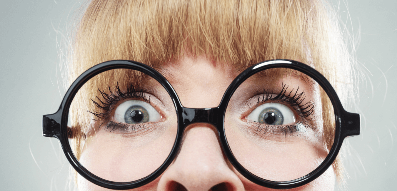 Extreme close up lady looking scared by competency-based interview questions