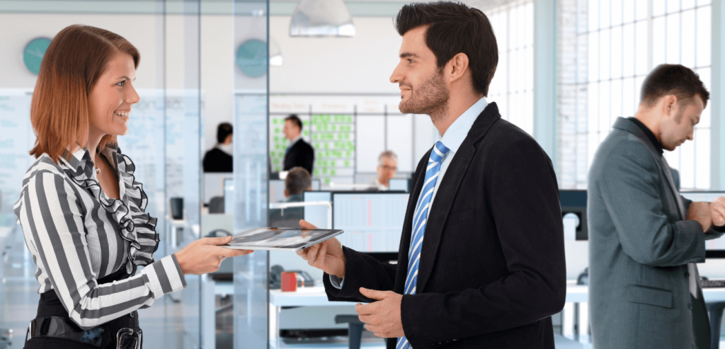 Workers in formal office attire in a corporate environment