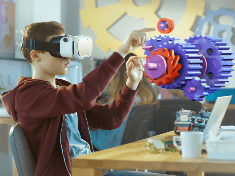 Boy learning about augmented reality