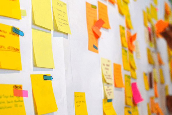 Agile vs waterfall? Both commonly involve many sticky notes on a whiteboard but which one is best for your career?